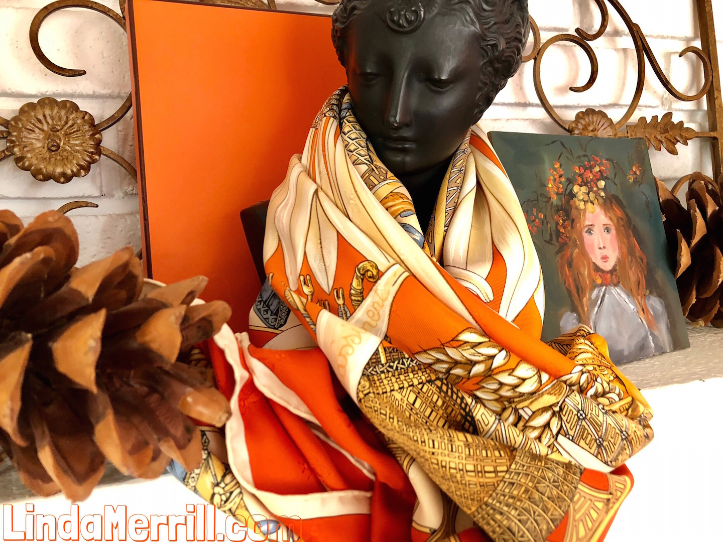 White brick fireplace, black bust, Hermes orange box, scarf, small oil painting, fall forward