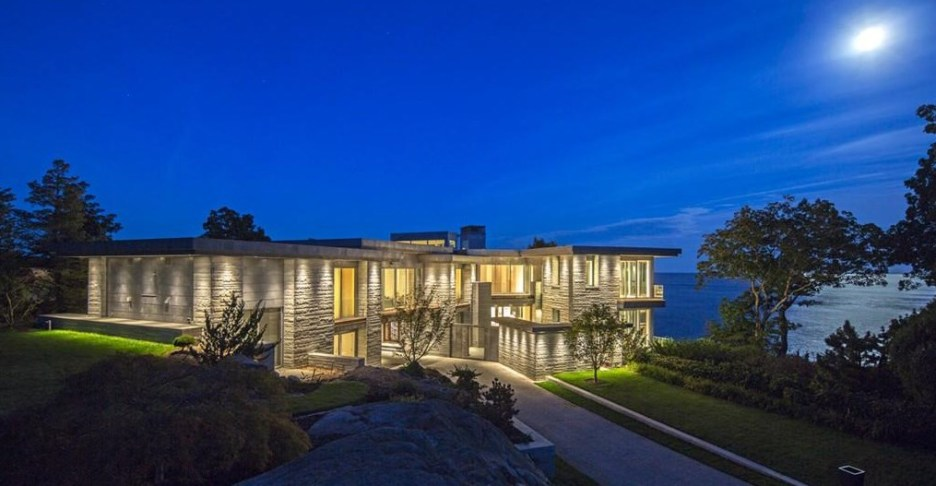 Spectacular oceanside modern beach house in Manchester-By-The-Sea Massachusetts. #modern #beach #coastal #home #oceanside #views #stone #glass