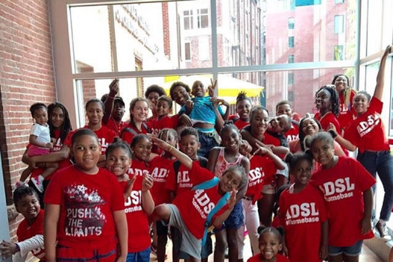 Kids in red t-shorts from All Dorchester Sports and Leadership