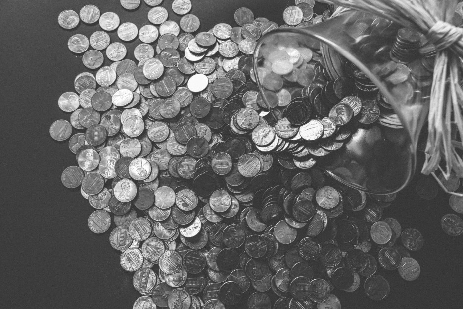 black and white image of pennies from a glass jar