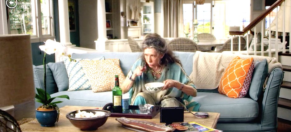 Grace and Frankie beach house Lily Tomlin blue sofa orange patterned chair