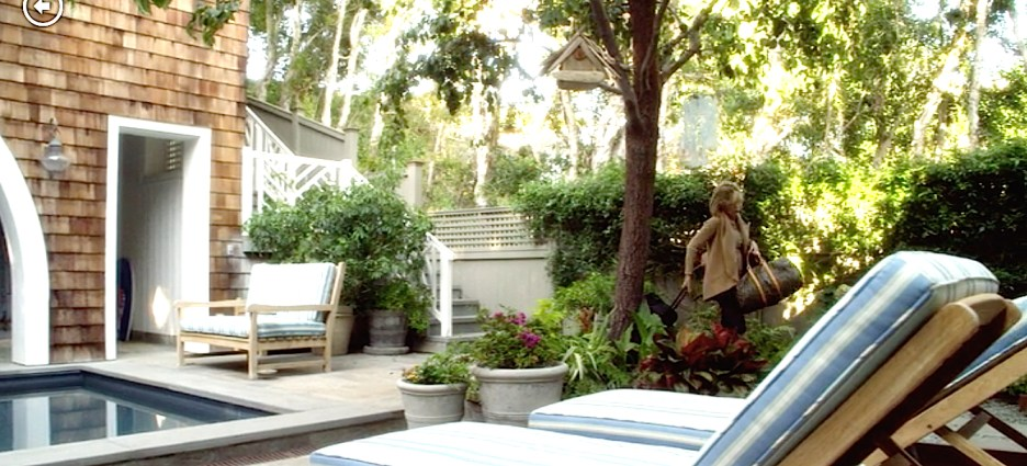 Grace and Frankie beach house pool backyard striped lounge chairs