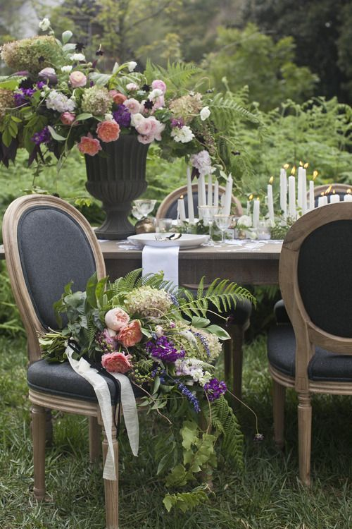 Outdoor Dining Garden flowers upholstered French Louis chairs and wood table