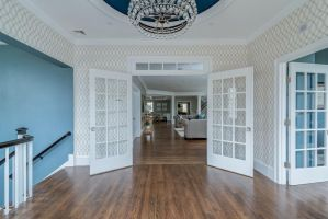 Hingham Church conversion open floor plan foyer with wallpaper blue ceiling