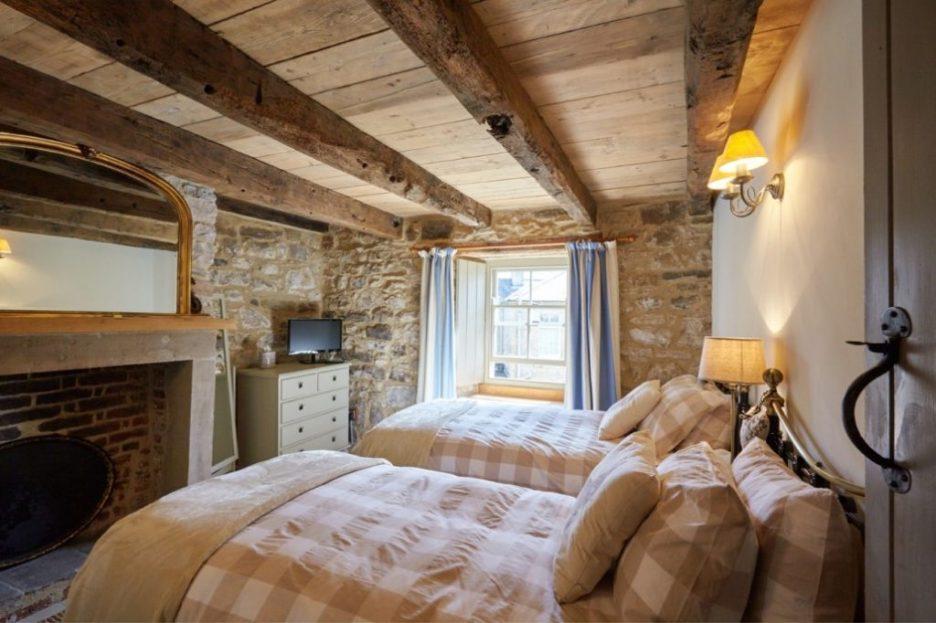 Tudor stone bastle Northumberland England Photo by David Webb Bastle twin bedroom Stone cottage