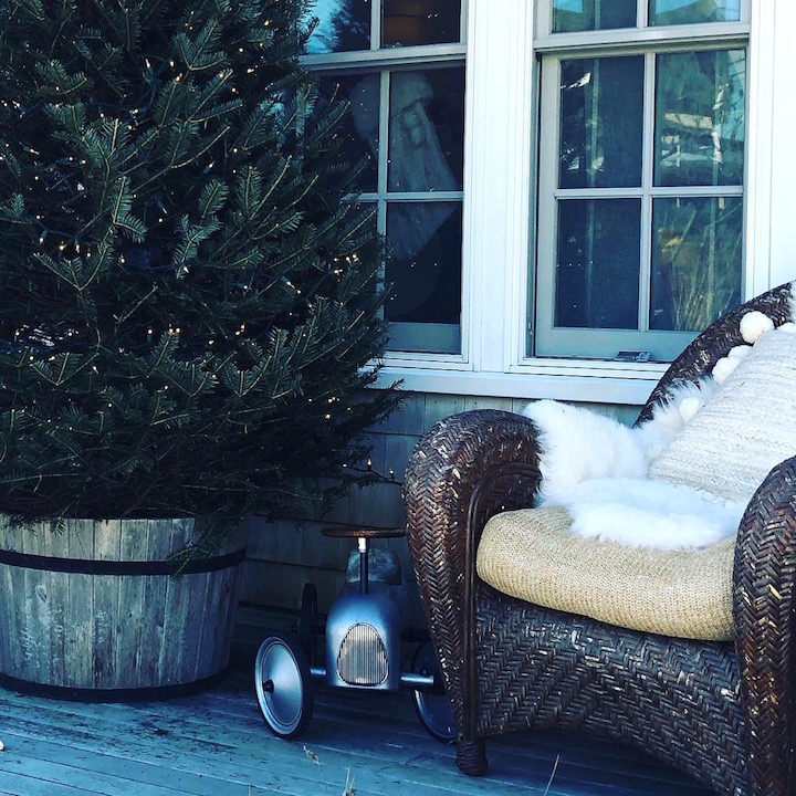 Plum island porch tree in wood bucket antique chair rattan chair Newburyport Christmas decorating house tour 2018