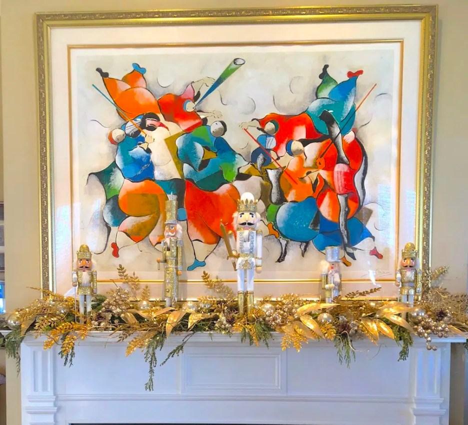 212 High Street Orange living room Christmas mantle nut cracker modern art Holiday House Tour 2018