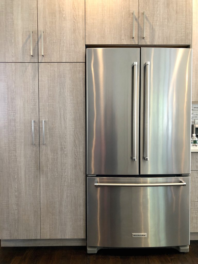 Merrimack St Kitchen cabinetry wall with fridge mid-size stylish kitchens