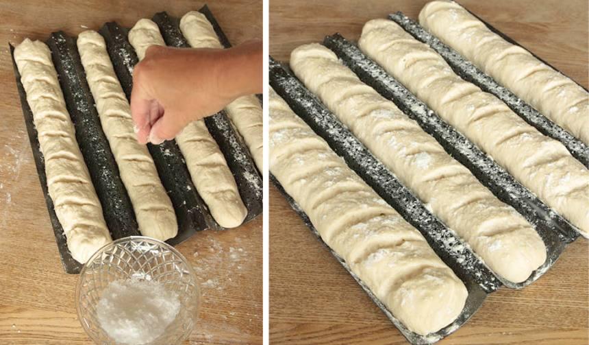 3. Skär några sneda snitt i ytan på bröden med en vass kniv. Pensla dem med vatten och strö över flingsalt och lite mjöl.