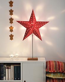 rød papirstjerne på eikefot woweffekt konstsmide