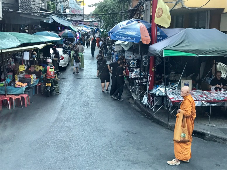 One of my favorite pictures...I love the peaceful monk in the chaos of the city!