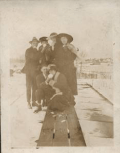 People on RR track in snow