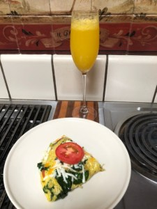 Summertime meals from Team Lind - Spinach and Tomato Omelet for Two best served with a mimosa
