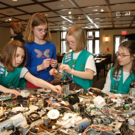 Girl Scouts playing with technology