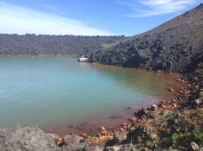 The iron and sulfur in the volcanic rocks dye the water various colors.