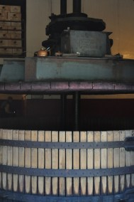 Manual wine press and gravity fed system in the Basque Rioja