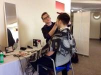 Satori stylist giving a student a haircut