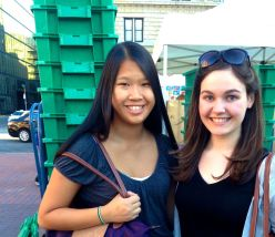 """Northeastern University freshmen Vera Lee (left) and Anna Iversen (right) were new to the Copley Farmer's Market. """"I like it because you're supporting the community, and things definitely do taste better,"""" said Vera."""