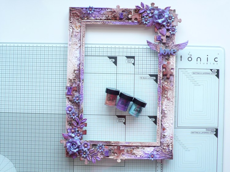 Step by step tutorail on how to alter a boring frame into a work of art