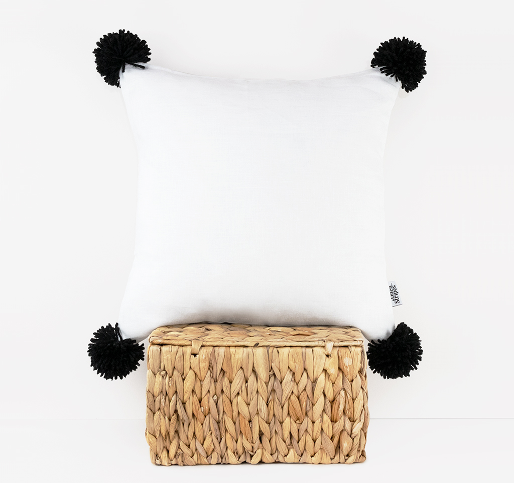 white linen pillow cover with black pompoms