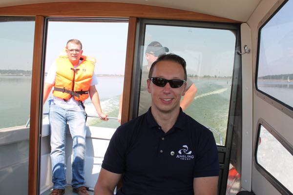 Martynas Pranaitis, an Angling Trust Volunteer Bailiff, who organised our meetings. Rado enjoyed the boat trip so much they he now wants a jet-ski – and with safety in mind has not just a lifejacket but what appears to be a complete life raft firmly strapped on!