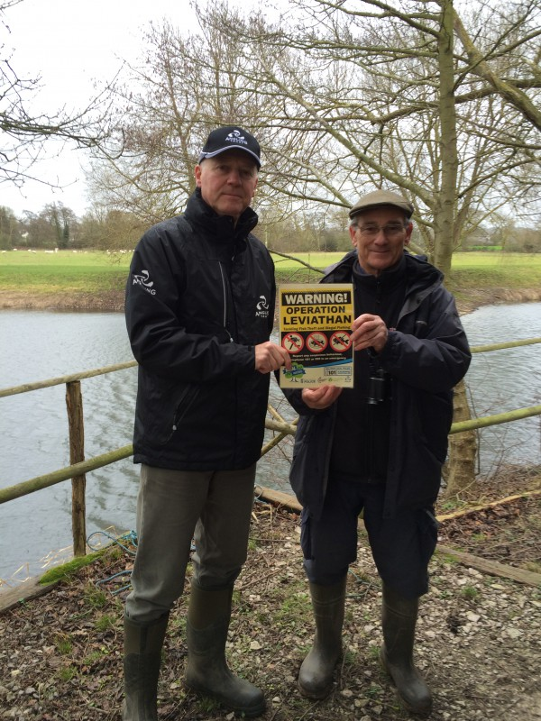 Operation Leviathan signs being put up at a local trout fishery where declining fish stocks are thought to be the result of poaching.