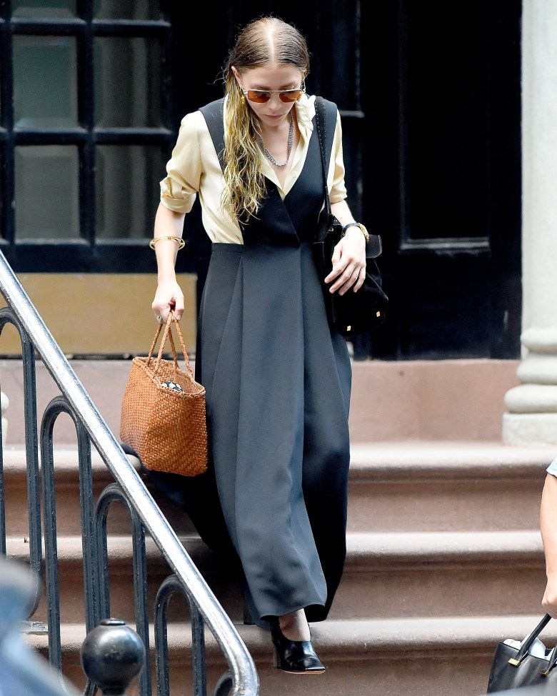 Mary-Kate Olsen leaves her home wearing a green dress in New York City