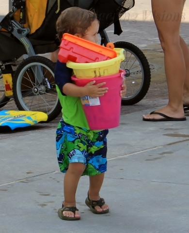 When at the beach EVERYONE carries something!