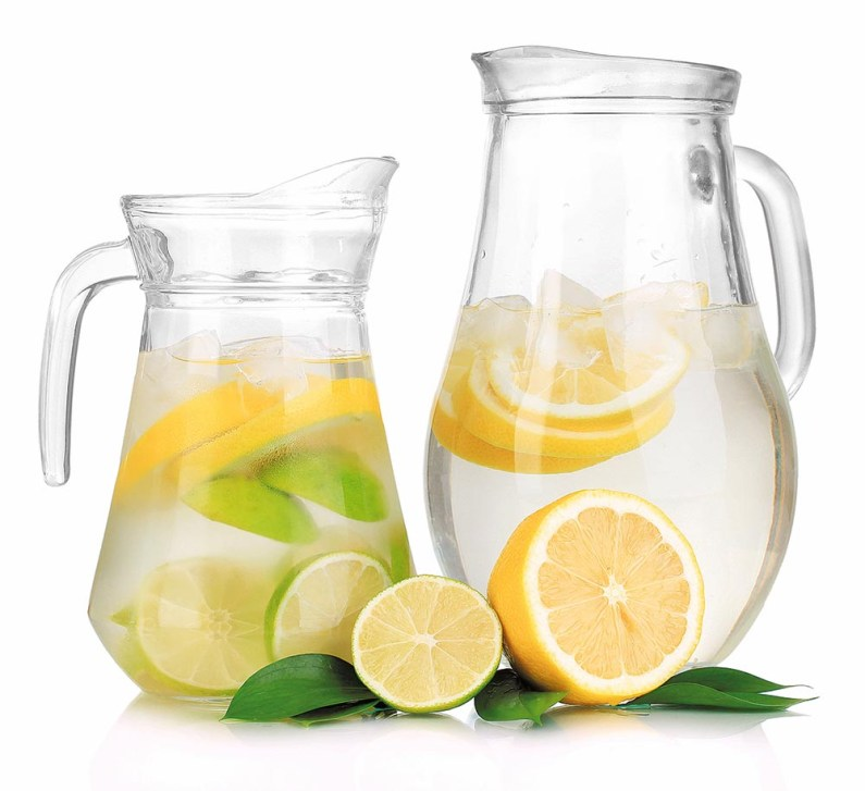 Cold water with lime, lemon and ice in pitchers isolated on whit