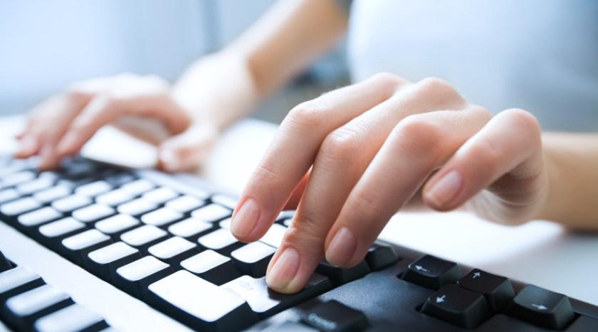 Fingers on computer keyboard