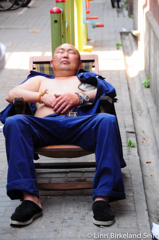 "Nothing like having a nap in ""fresh"" smog air. Shanghai, China – 2013."