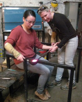 Rolling and cupping the molten glass