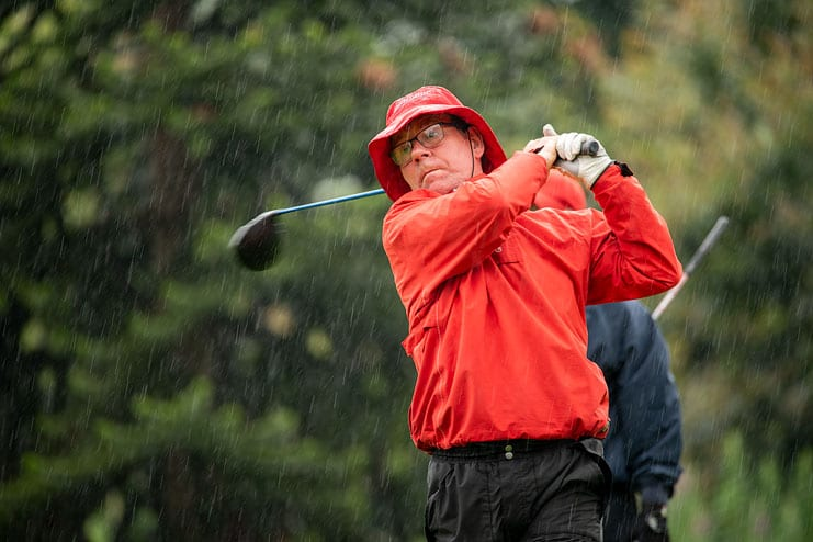 golf action in the rain