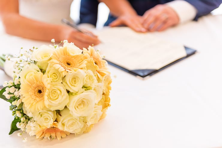 brides bouquet of yellow flowers on table