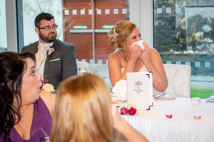 The bride is embarrassed during speeches