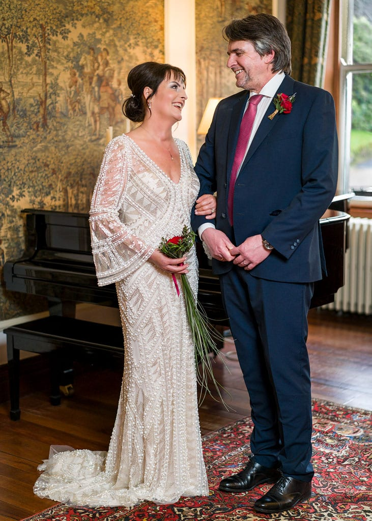 full length portrait of the bride and groom