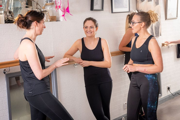 pilates students in conversation during a break