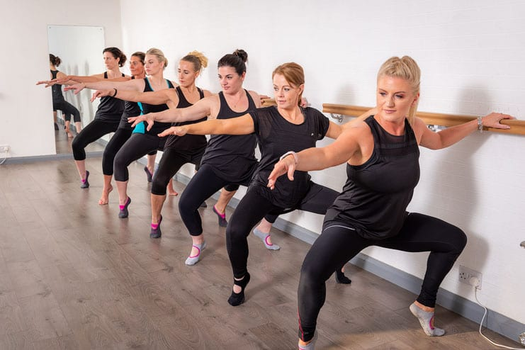Lesley Bell leads pilates students