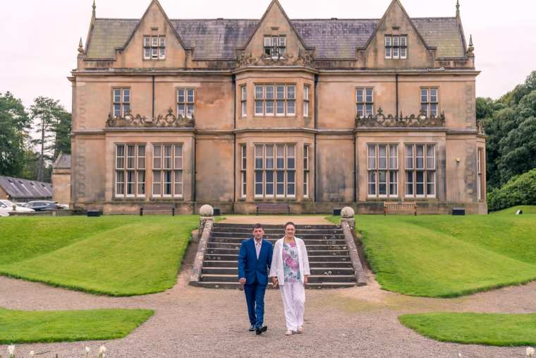 bride and groom in front of bangor castle