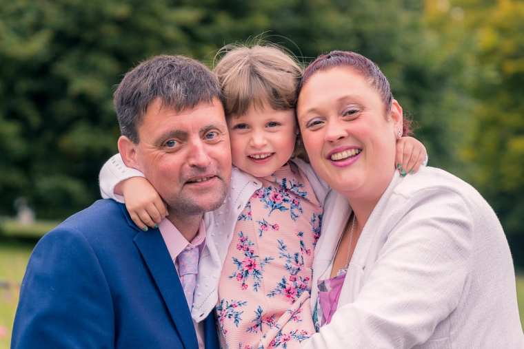 bride groom and daughter family photography