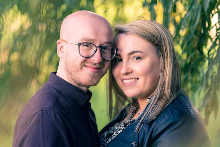 head and shoulders couple portrait under willow tree