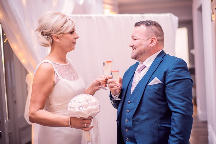 the bride and groom toast their marriage
