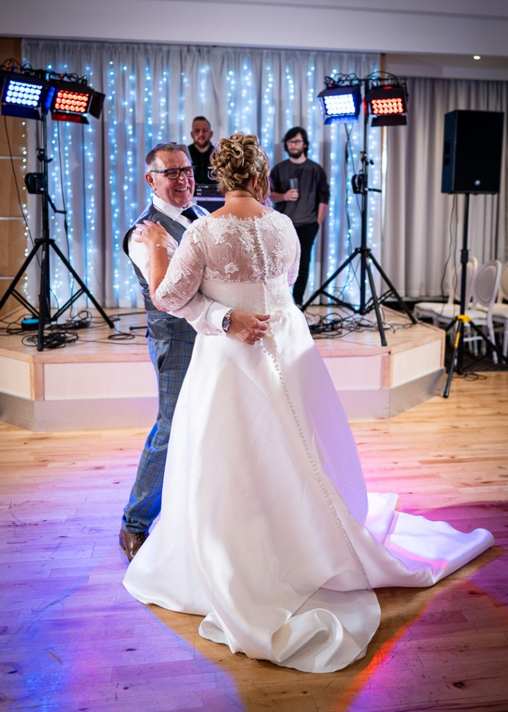 Bride and groom first dance reportage wedding photography