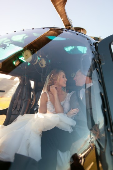 bride and groom kissing in a helicopter in new zealand