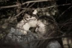 groom kissing bride monochrome