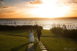 auckland wedding bride and groom walking into the sunset
