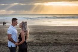 auckland engagement photo couple sunset piha
