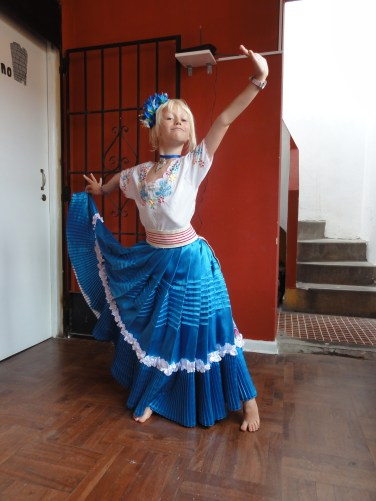 trying out a Marinera costume in Lima