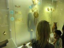 A studying the objects at el museo del oro in Bogota