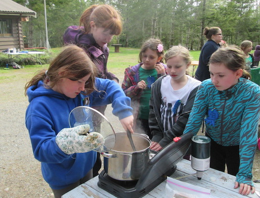Girl Guides cooking at camp